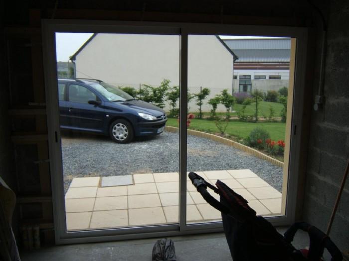 Installer une baie vitrée pour remplacer une porte de garage - Vitrier sympa